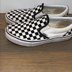 White and black checkered vans